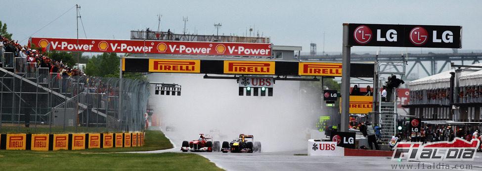 Alonso y Vettel en la salida del GP de Canadá 2011