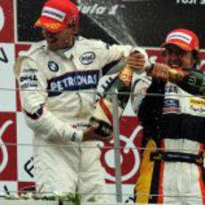 Alonso y Kubica en el podio