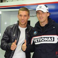 Kubica y Podolski