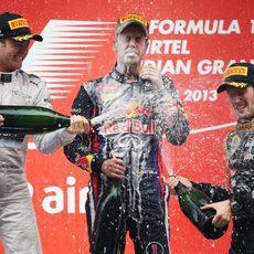 Nico Rosberg, Sebastian Vettel y Romain Grosjean en el podio