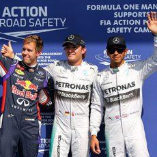 Rosberg, Hamilton y Vettel saludan a las cámaras en Spa
