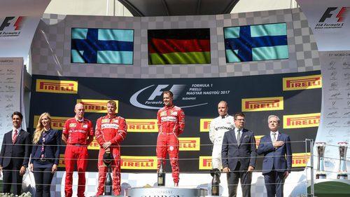 Vettel, Räikkönen y Bottas, los hombres del podio