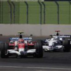 Glock delante de Rosberg