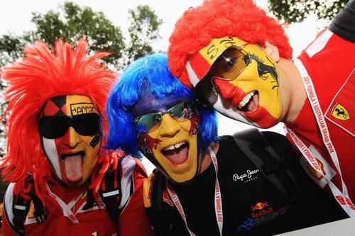Caras pintadas de Red Bull y Ferrari