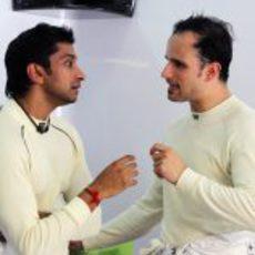 Liuzzi y Karthikeyan compartiendo información
