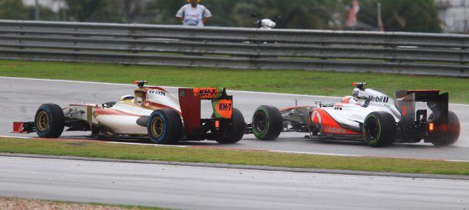 Karthikeyan y Button en el GP Malasia 2012