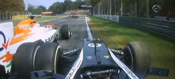 Senna intenta pasar a Di Resta en el GP de Italia