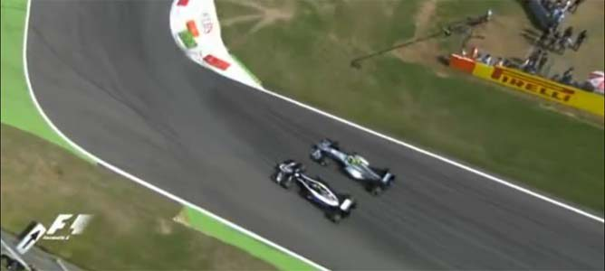 Senna intenta adelantar a Rosberg en el GP de Italia