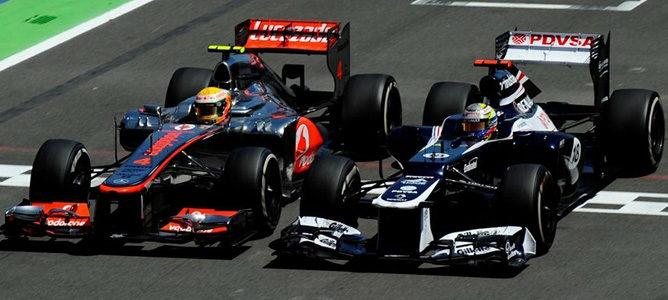 Lewis Hamilton y Pastor Maldonado en Valencia