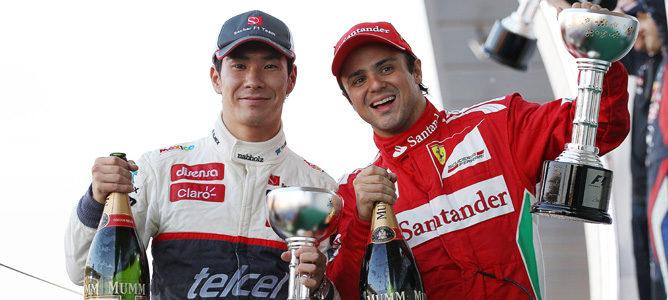 Kamui Kobayashi y Felipe Massa en el podio de Japón 2012