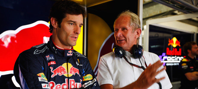 Mark Webber y Helmut Marko en el box de Red Bull
