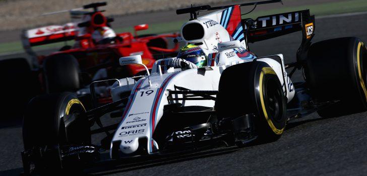 Massa y Vettel detrás