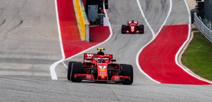 Räikkönen y Vettel, en el pit lane de Austin
