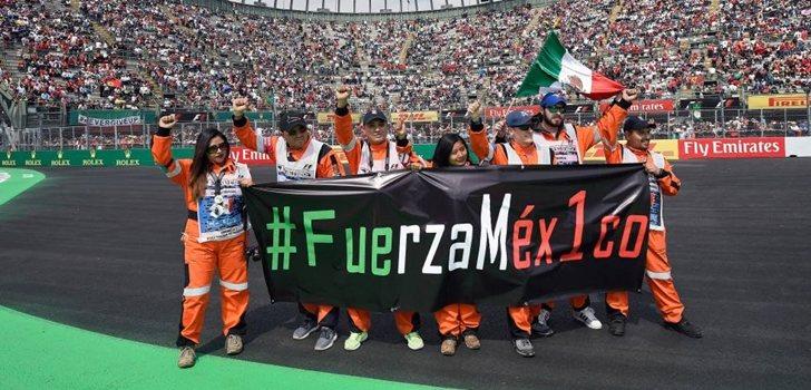 Comisarios con la bandera de México